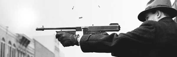 Gangster firing a Thompson Submachine Gun