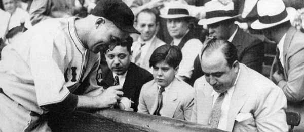 Cubs player signs ball for Capone's kid.