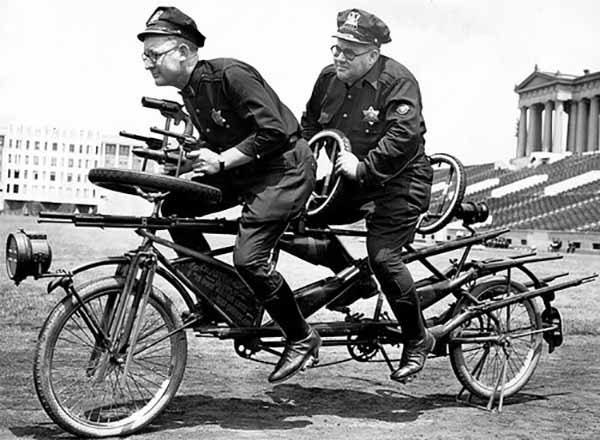 Chicago Police officers on an armed tandem bike